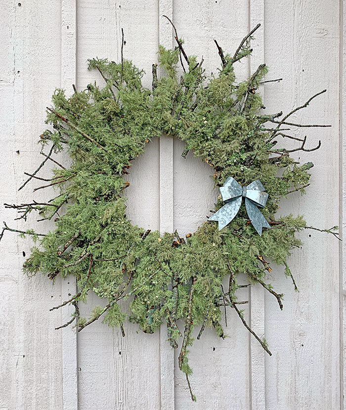 Here is how the wreath looked once I hung it outside in the moist air. You'll notice that the color of the lichen changes when it's raining or the air is very moist.  This is a wreath that should be hung outside, since the lichen is much larger and more beautiful when it periodically gets wet.